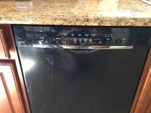 Bosch SHE4AP06UC/06 dishwasher installed under kitchen counter