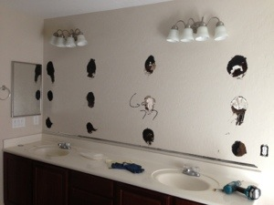 Bathroom Mirror Glued To Wall how to repair a large sinking bathroom double-sink vanity mirror