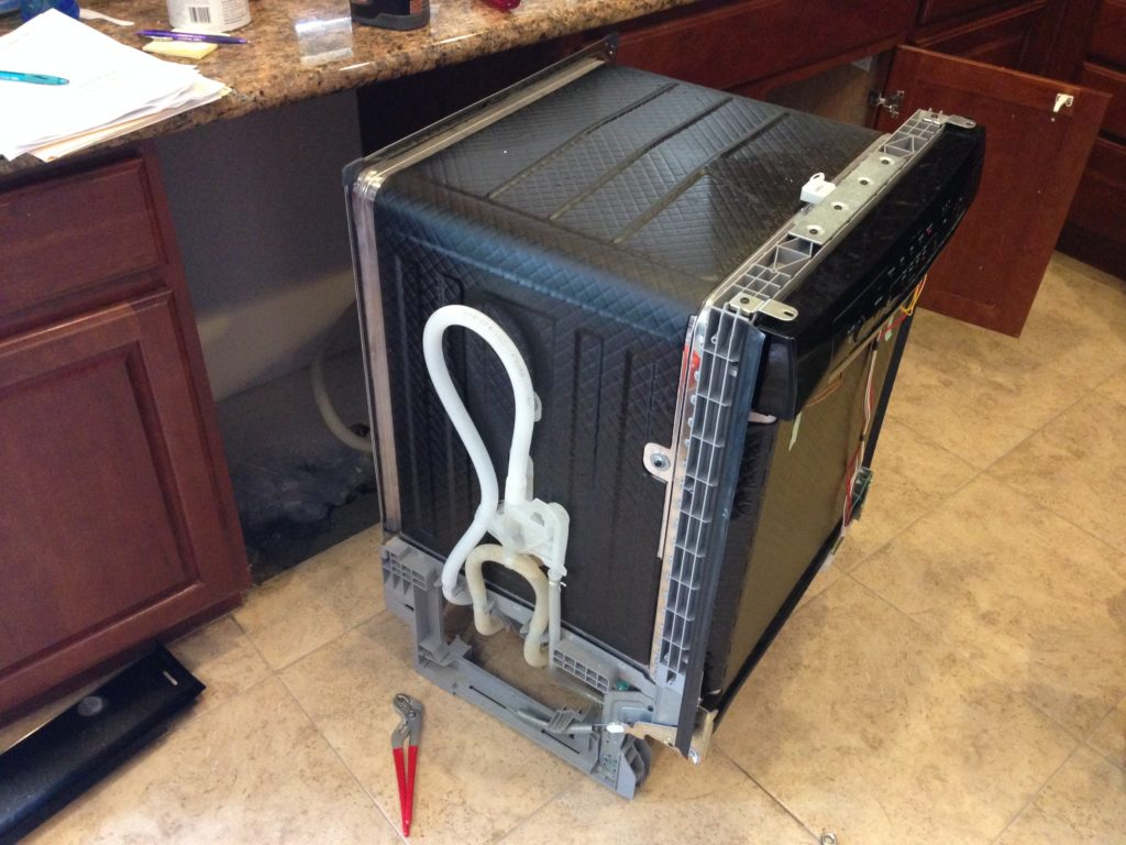 Bosch Dishwasher removed from cabinet showing drain pipe