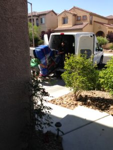 Las Vegas' Best Local Piano Movers taking grand piano off the delivery van
