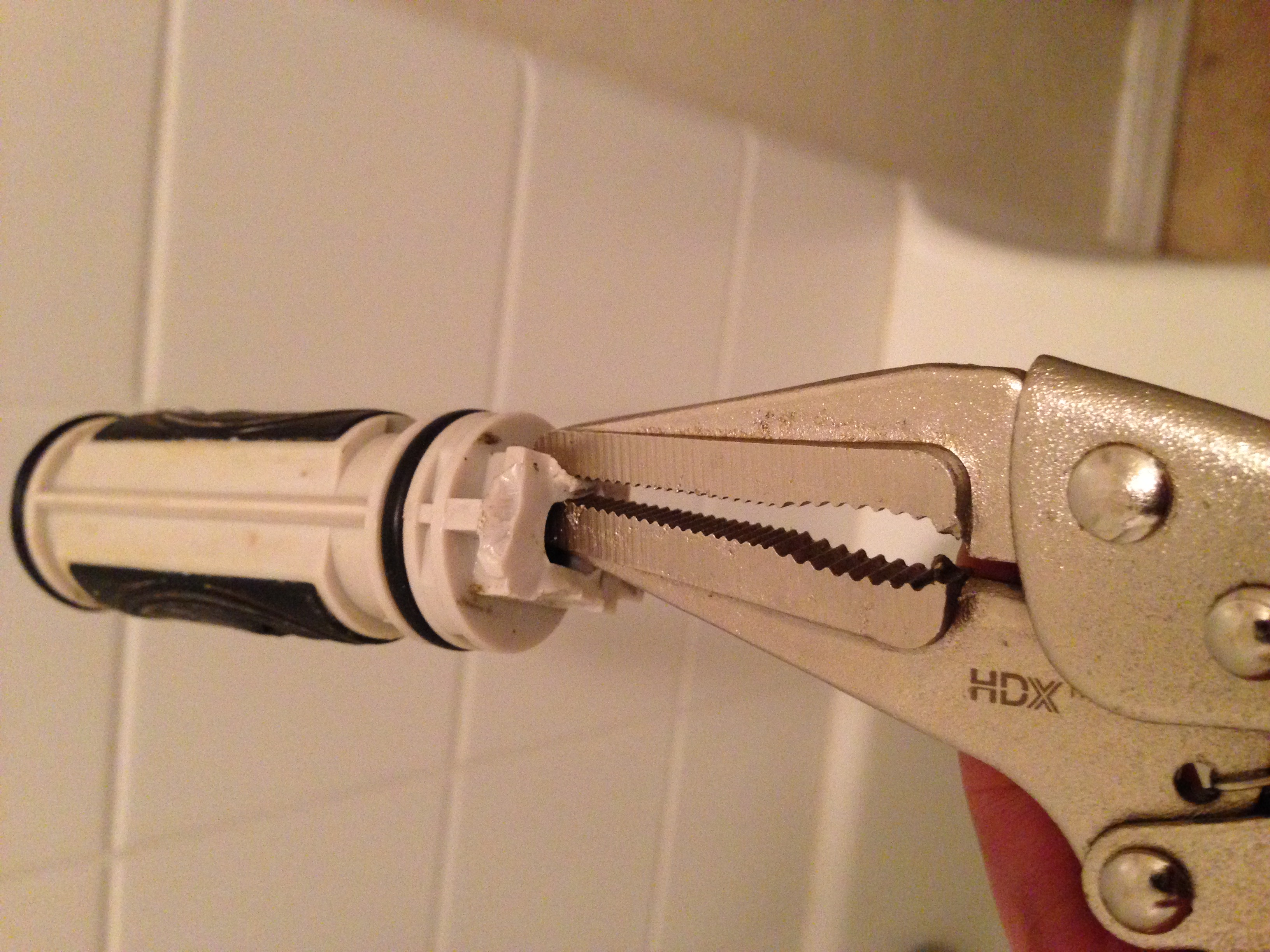 Using Locking Needle Nose Pliers To Remove Moen Valve With Broken Stem