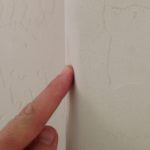pointing to dented rounded bullnose drywall corner