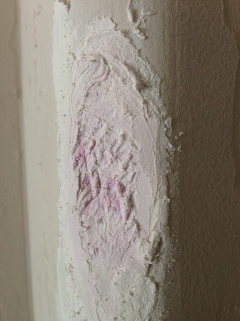 spackle drying in dented drywall rounded corner