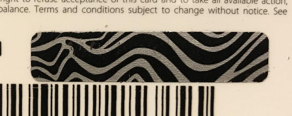 legitimate Walmart gift card with untampered scratch off strip