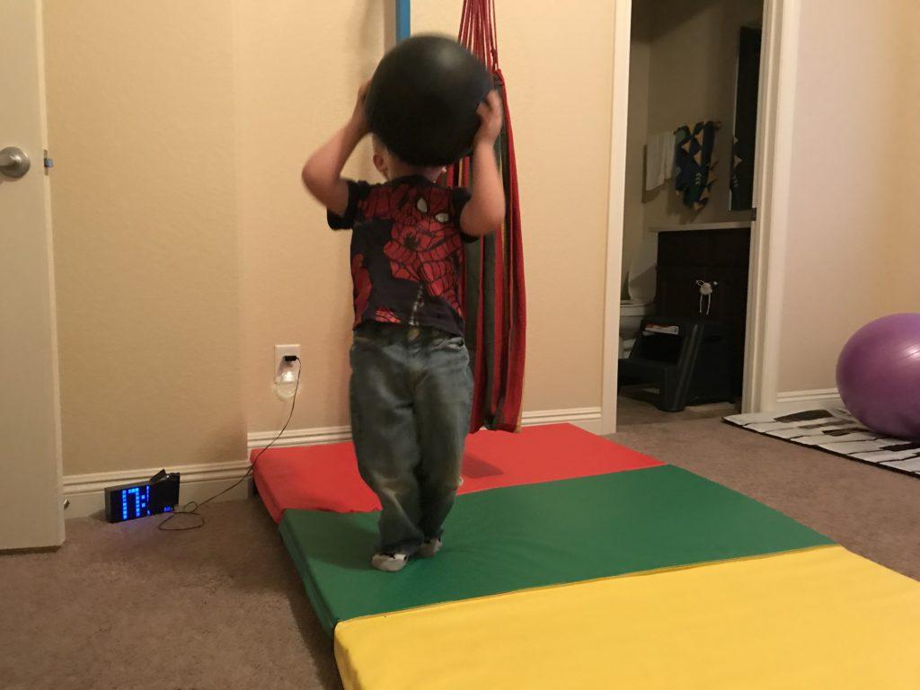 hyperactive boy active room - lifting medicine ball