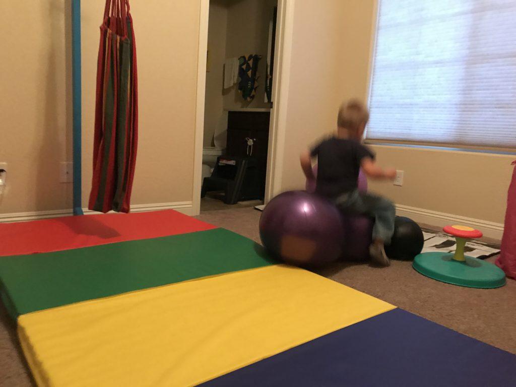 hyperactive boy active room - riding peanut ball