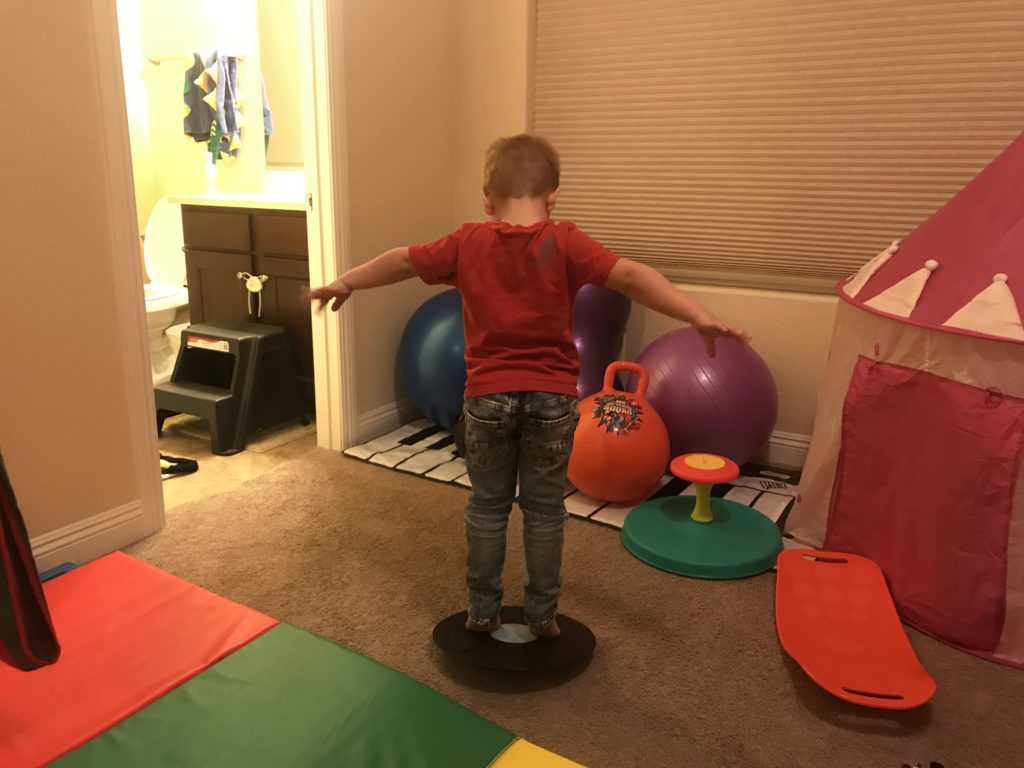 hyperactive son on wobble balance board