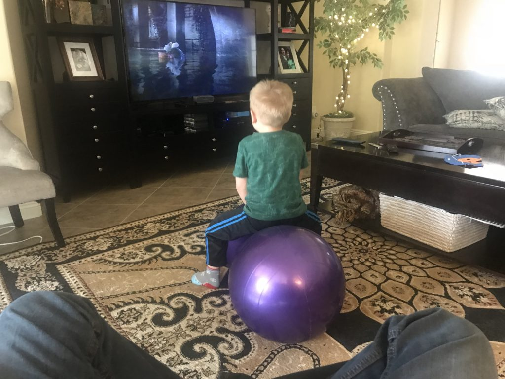 my-hyperactive-son-bouncing-on-a-peanut-gym-ball-while-watching-tv