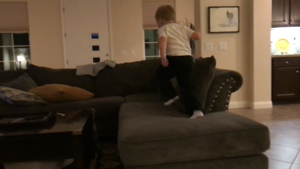 my hyperactive son running on the couch while watching tv