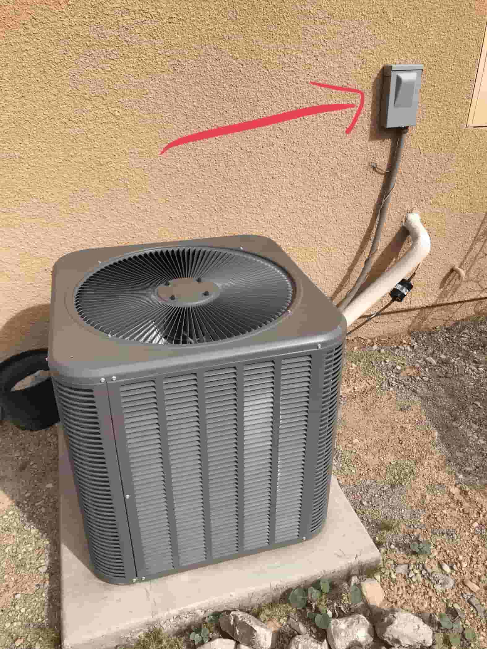 Circuit breaker next to air conditioning condenser unit to cut when installing a Hard Start Kit