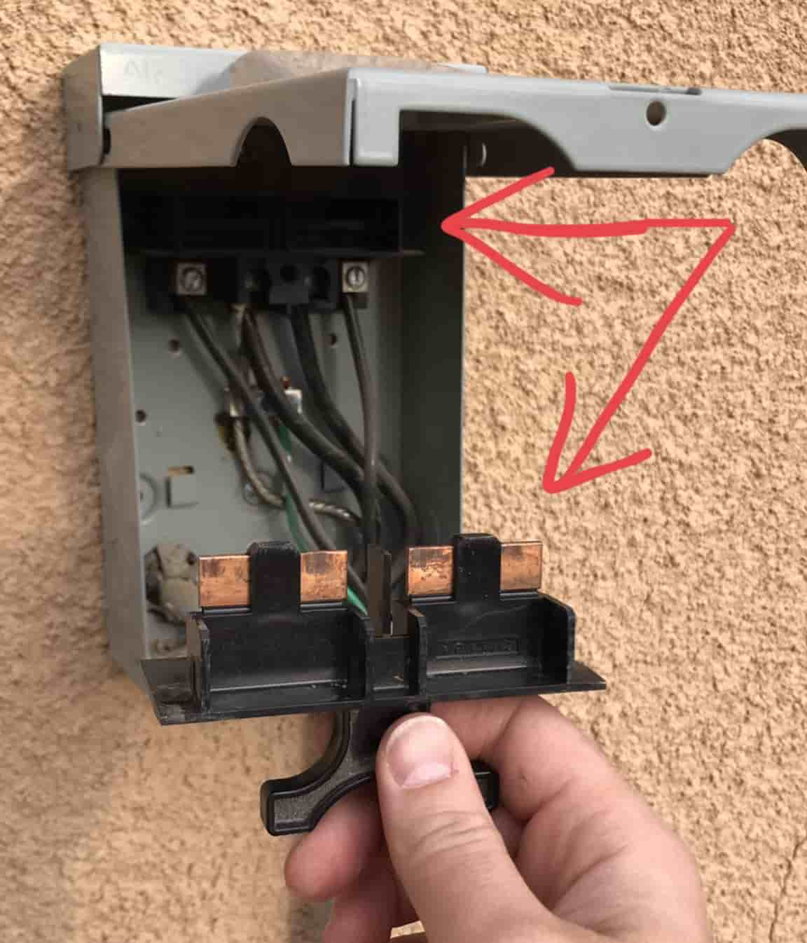 Removing the circuit breaker on the power box before installing a hard start kit